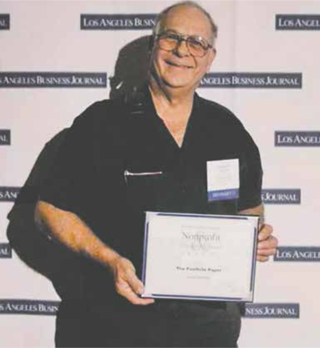 "David ""Doc"" DeMulle' receives award from the L.A. Business Journal during awards ceremony"