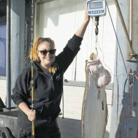 Sierra Perez with her 54.5-pound halibut.