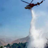 Water dropping helicopters protect Alpine Way houses.