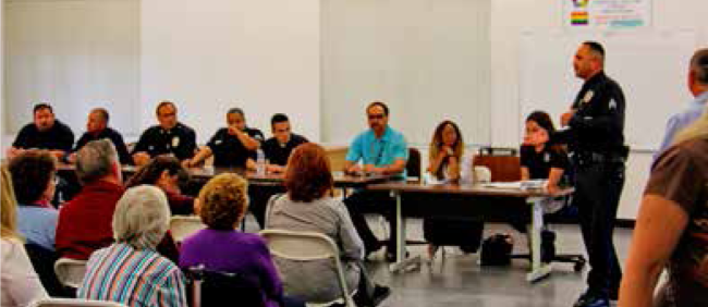 LAPD officers discuss community concerns with an unhappy audience.