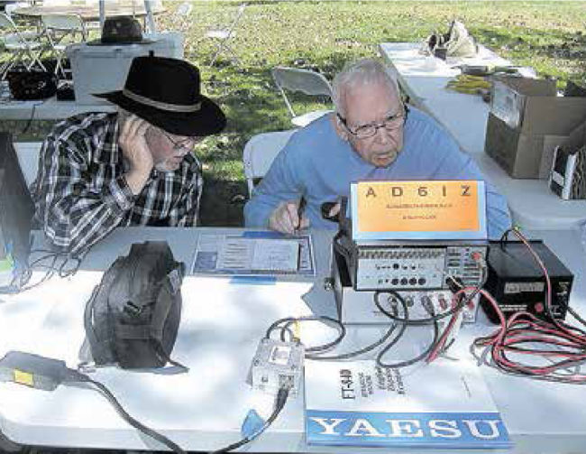 Larry and Ray listen closely to their to single sideband radio