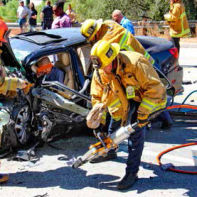Using the Jaws of Life to extricate one of the survivors of the latest fatality-laden collision along La Tuna canyon Road.
