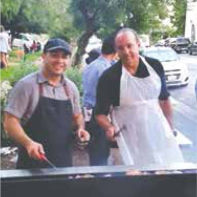 Chefs Arnie and Egger getting ready to cook for 100 people.