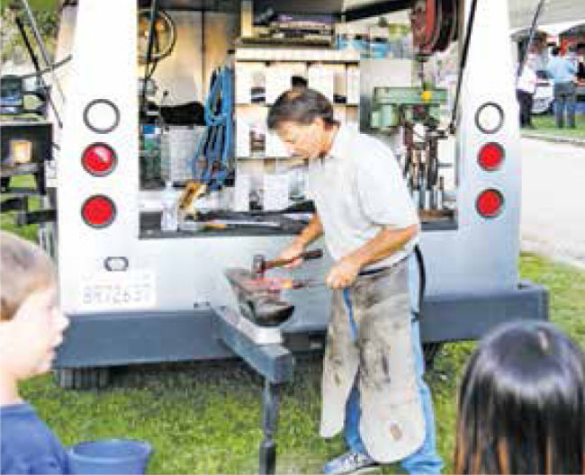 The mobile farrier shows how he makes and fits horse shoes.