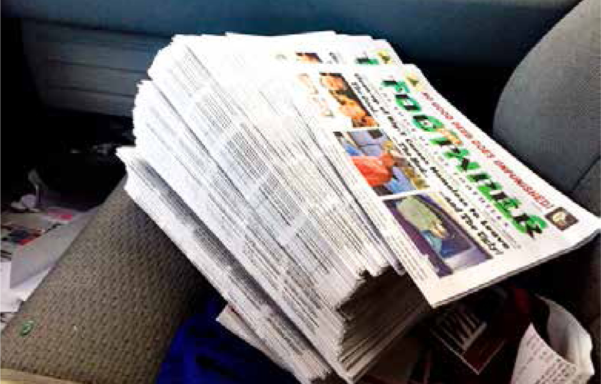 A stack of approximately 100 copies of stolen newspapers photographed by Koesler as the papers sit in his truck.