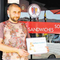 "Albert Kirkosyan, proud owner of Shawarma House with his L.A. County-issued Gold ""A"" award."