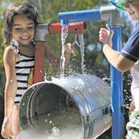 Harlow Contreras and Liam Baghdasarian enjoy dumping water on a hot day.