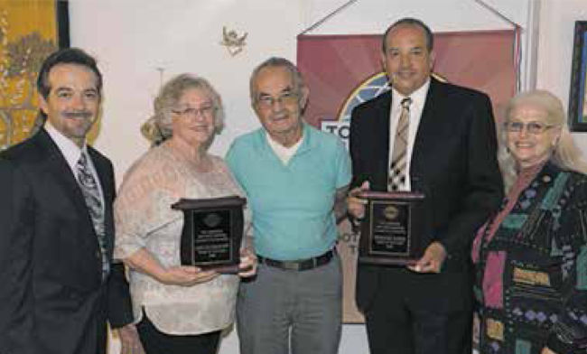 "Marlene and Lloyd Hitt along with Herrold Egger receive the ""Toast Of The Town Award"" for their community service."