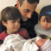 Alejandro Magallanes (center)welcomes his new baby daughter, Alex Grace. At his left and right, respectively, are Magallanes' two sons, Santiago (6) and Elijah (4).
