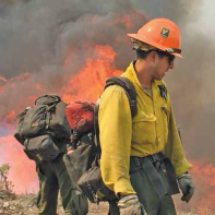 U.S. Forest Service members manage a prescribed burn. (Photo from the U.S. Forest Service's Facebook site.)