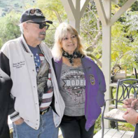 Legion Auxiliary members Joan Slater and Wendy Freeman with Post Chaplain Bud Fales present a check to Johnny Higginson at his Shadow Hills Equestrian Center where the Saddles for Soldiers program is operated.