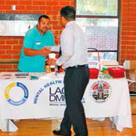 DMH worker gives out information on services available.