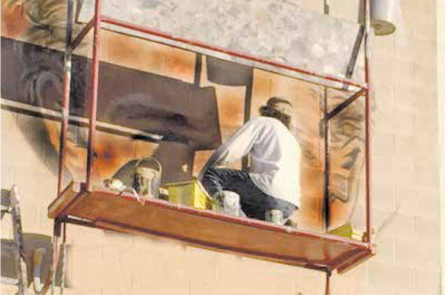 Artist Nerses paints from a scaffold.