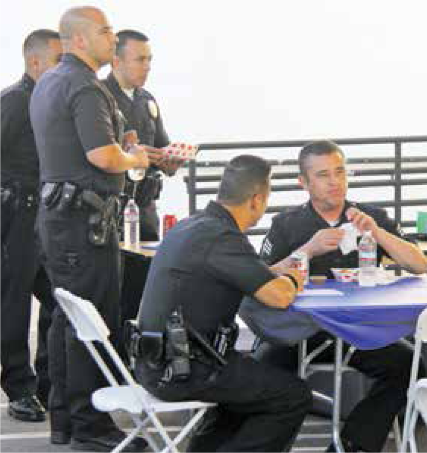 The owners of Epic Tacos, Sandra and Edgra Ruiz, delivered free dinners to officers at the LAPD's Foothill station at 6 p.m. as the shift changed and the hungry officers emerged from the station.