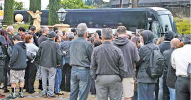 More than 100 people boarded buses at the Great Caesars Banquet Hall Monday.