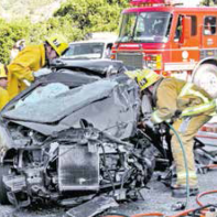 "Firefighters use ""jaws of life"" to extricate trapped driver."