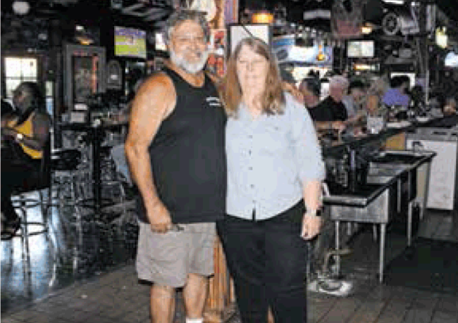 Art and Sue Miner making people happy — and don't forget the Roger Swart Big Mouth Sandwich!