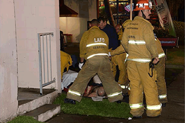 Firefighters stop bleeding of Sunland McDonald's attempted robbery victim last Thursday. Photo by Rick McClur
