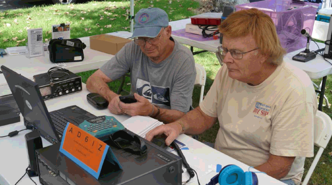 Michael L. Lichtman (KF6KXG) and Mark Kanzler (KE6ZLP) prepare radios for Field Day
