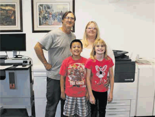 Robert, Julie, Kristoffer and Kayla Ward in front of their Super Printing Machine!