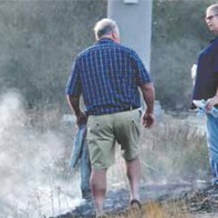 Residents take a minute to put out grass fires off of La Tuna Canyon Road