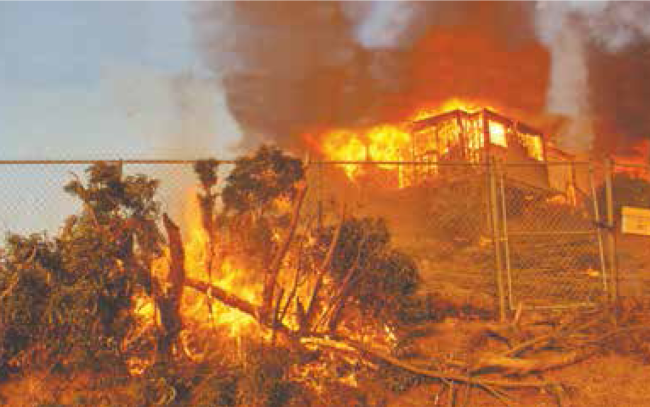 One of eight houses destroyed by fire in Shadow Hills on Sunday.